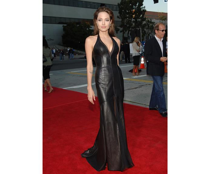 At the Los Angeles Premiere premiere of *Mr. & Mrs. Smith*, the film that alledgedly won her Brad Pitt, Angelina's leather dress turned not only heads, but the tide of fashion.