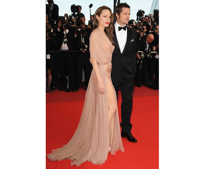 At Cannes in 2009, Angelina turned heads on the arm of Brad Pitt, in this nude semi sheer number.