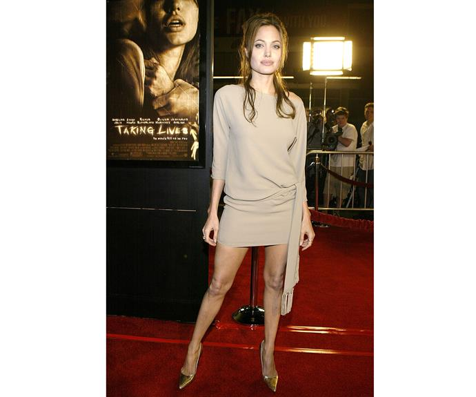 The star flashed her legs at the premiere of *Taking Lives* in 2004.