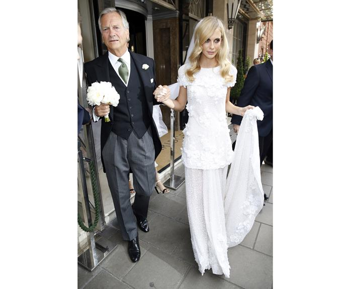 Poppy Delevingne and her father Charles Delevingne leave Claridges Hotel on their way to Poppy's wedding on May 16, 2014 in London, England.