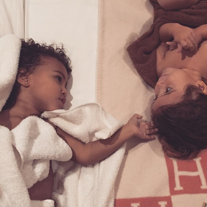 North reaches out to her cousin Penelope in this adorable photo.