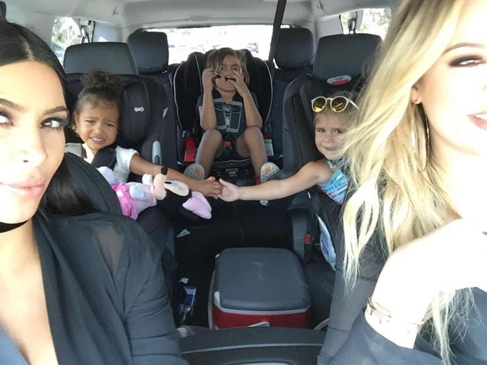 """""""ROAD TRIPPIN'"""" said North's mummy Kim Kardashian. North and her cousin Penelope Disick, Kourtney Kardashian's daughter, held hands tightly as Penelope's big bro Mason fumbled with his aviators. Aunt Khloe looked like she was having so much fun!"""