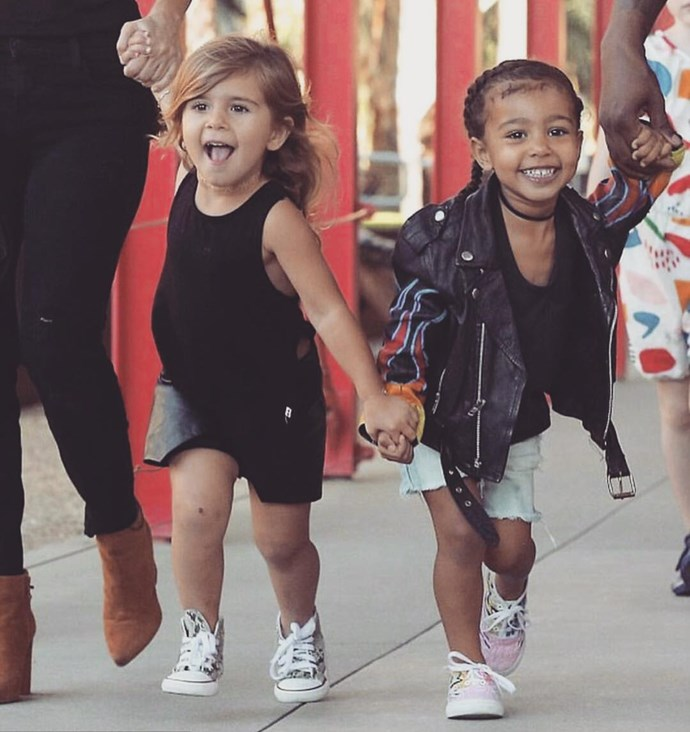 North and her cousin Penelope look excited to be holding hands in this sweet shot. Watch the pair pretending to be Kylie and Kendall in the next video - gallery continues after video.