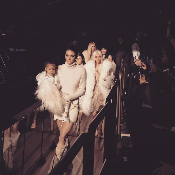 Kendall (holding North) led the charge as the family made a dramatic entrance to Paris Fashion Week in 2016.
