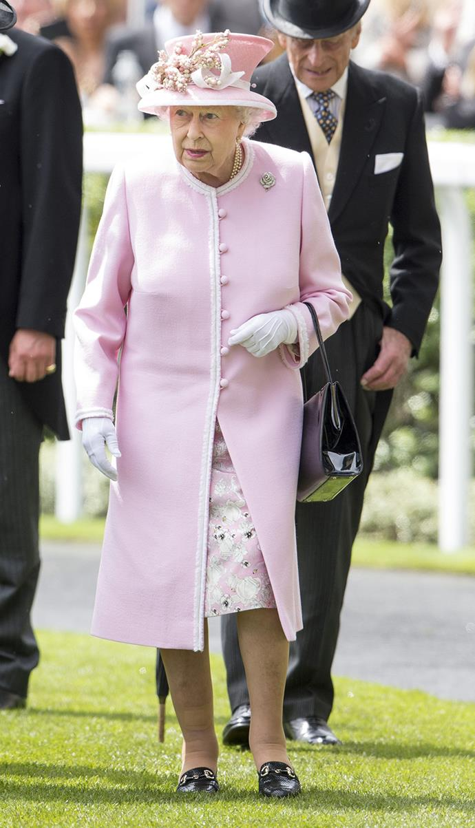 The monarch's hat featured a matching arrangement of ornamental pink and white berries on the brim.