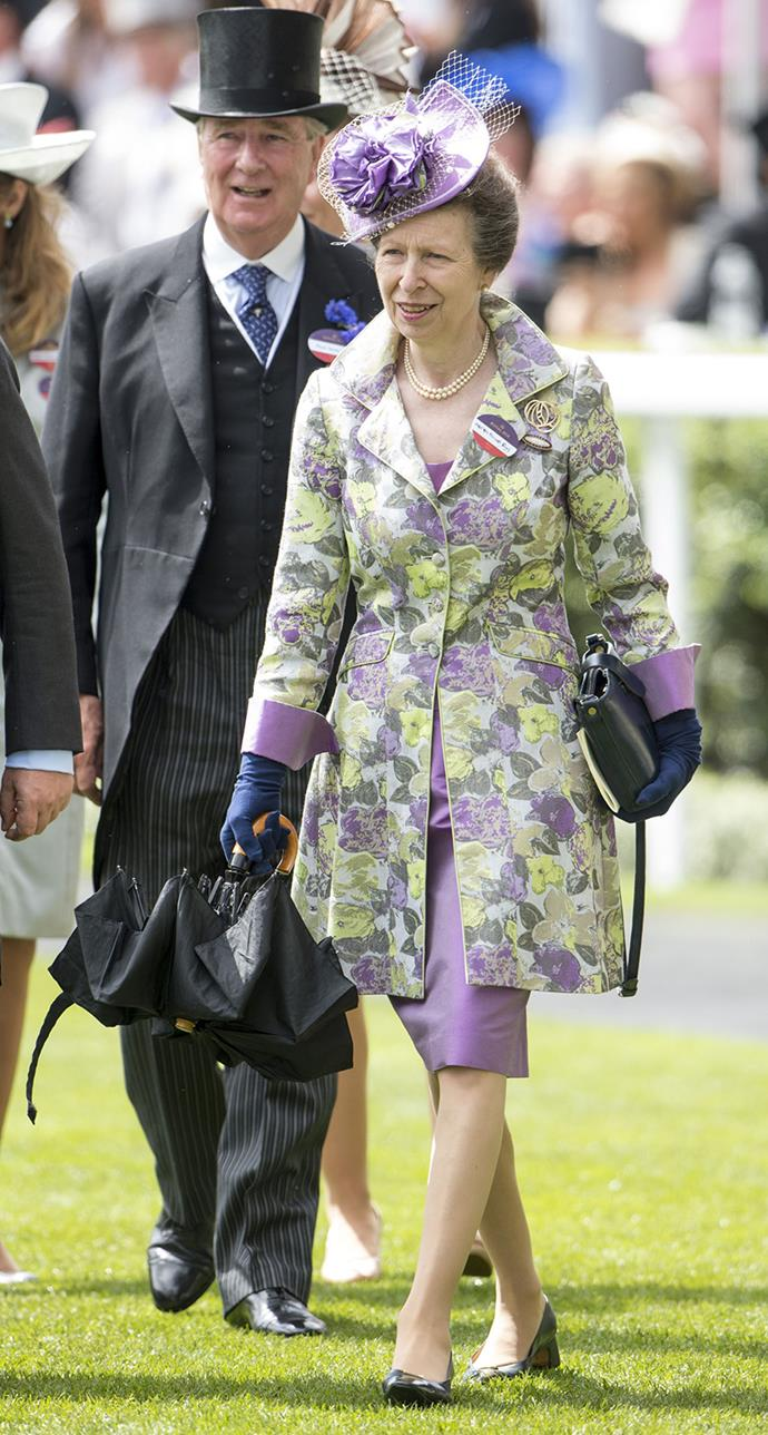 Princess Anne was decked out in purple tones and a floral coat for the occasion on day two of the races.