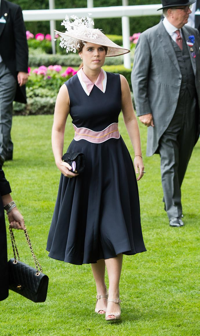 Princess Eugenie donned a navy blue dress from designer Roksanda Illincic, which featured splashes of colour on the collar and waistband.