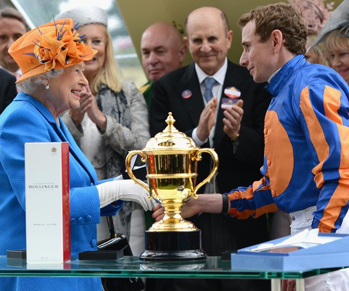 Her Majesty presents jockey Ryan Moore with the Gold Cup Trophy in honour of her 90th birthday.
