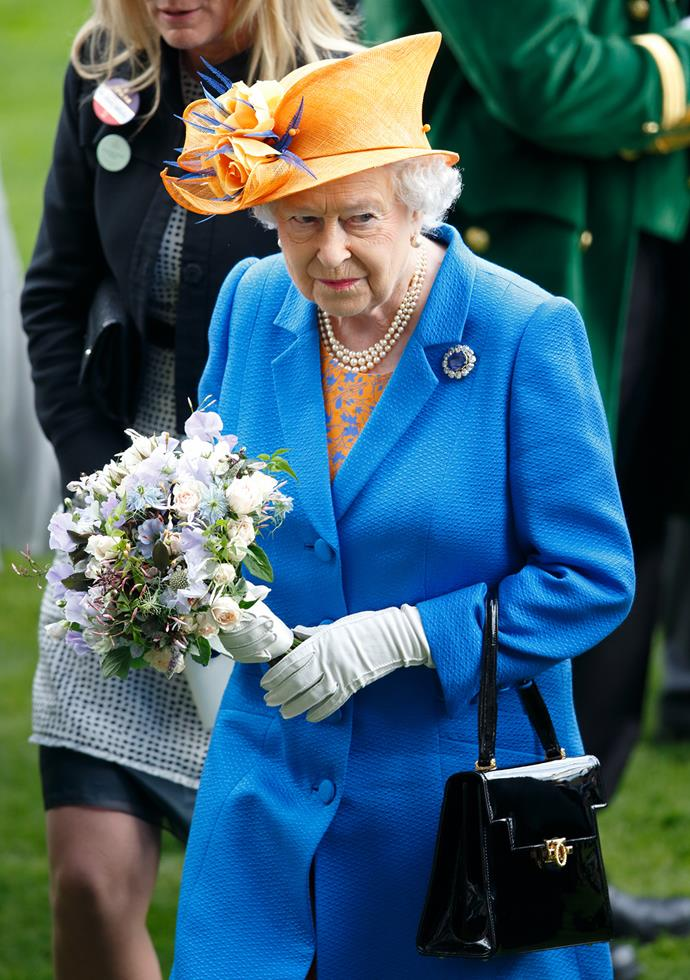 On day three of the Royal Ascot, the Queen stood out with her vibrant blue and orange ensemble.