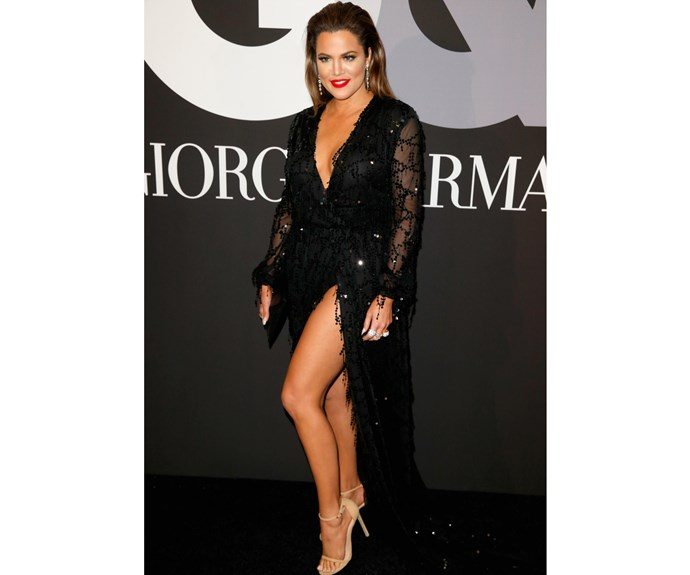 In early 2015, Khloe wowed in this sparkling gown that showed off her trim and toned legs. **Watch Khloe working out with her trainer and Kourtney in the next video - gallery continues**