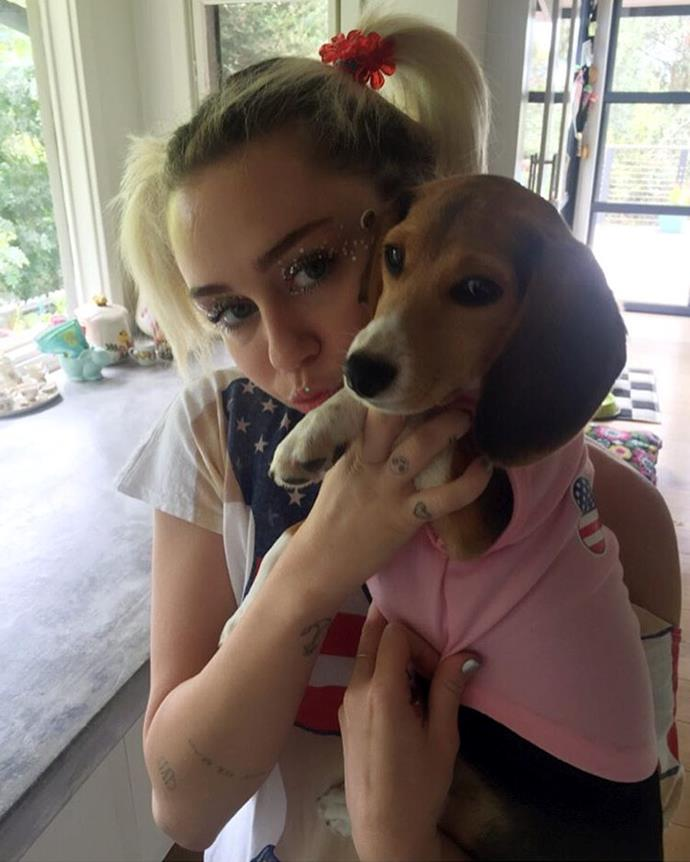 Miley Cyrus posed for a 4th of July photo with her dog Barbie.