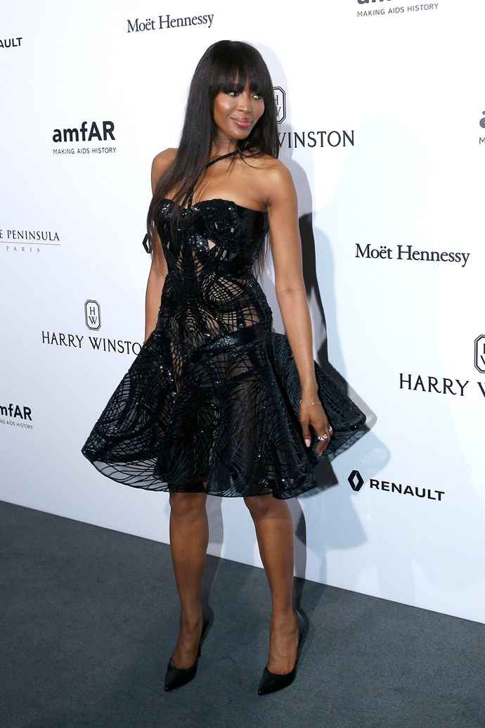 Naomi Campbell put her best foot forward on the grey carpet at the amfAR dinner.