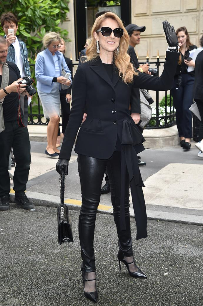 Celine Dion waves to the crowds as she arrives at the Dior show during Paris Fashion Week.