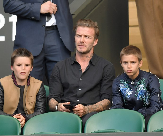 David Beckham catches the action at Wimbledon with his sons Cruz and Romeo.