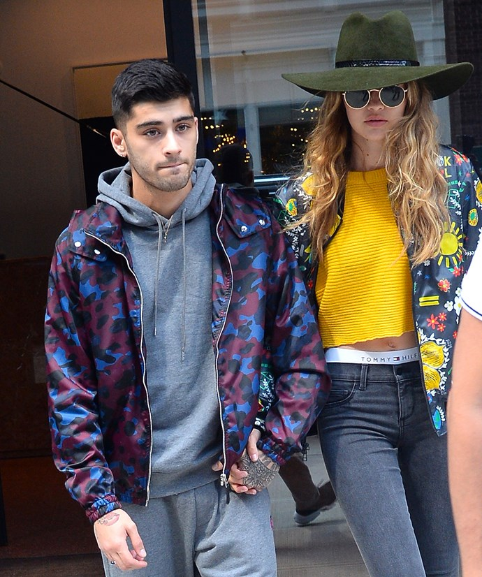 Zayn Malik and Gigi Hadid hold hands as they walk in New York City.