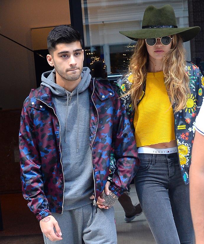 Zayn Malik and Gigi Hadid hold hands as they walk in New York City.