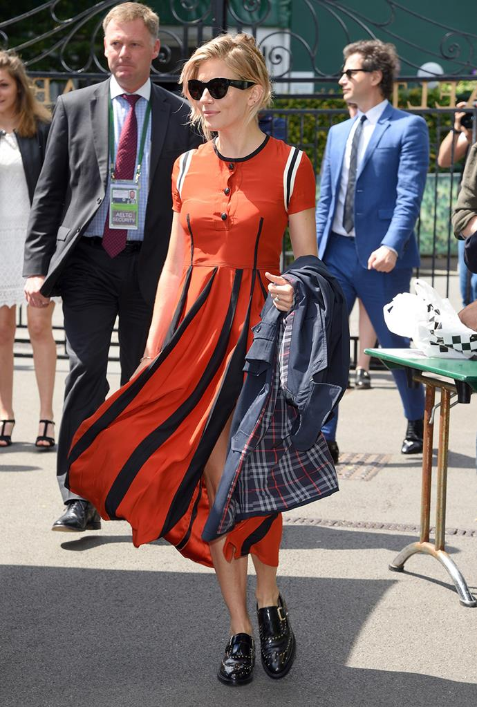 Sienna Miller looked enviably cool in a Burberry midi-length dress, with matching black shades.