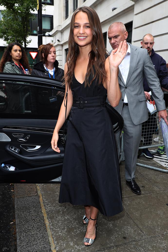 Alicia Vikander waves as she leaves the BBC Radio2 Studios in London, on a promotional tour for her new film *Jason Bourne*.