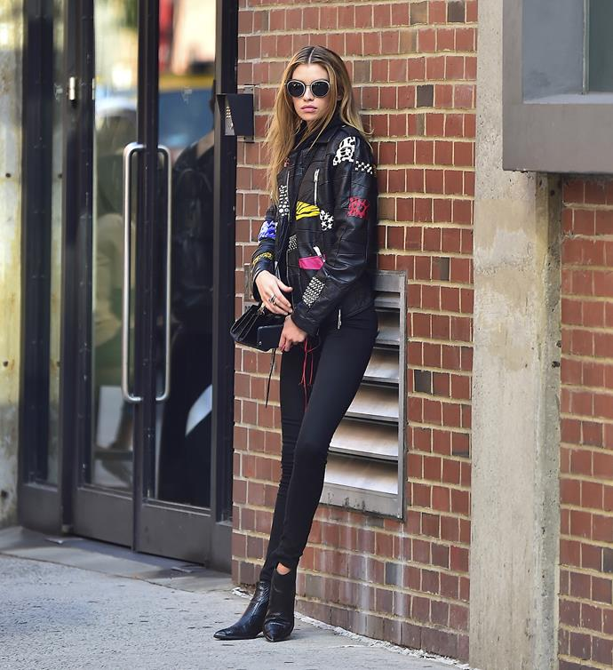 Model Stella Maxwell dons shades and black leather in New York.