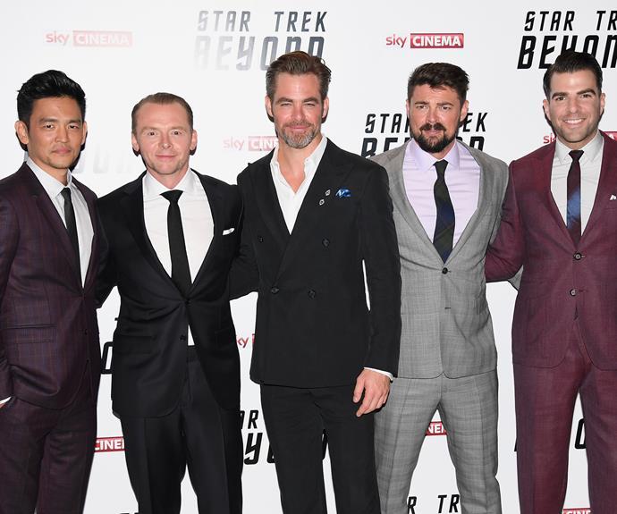 John Cho, Simon Pegg, Chris Pine, Karl Urban and Zachary Quinto pose together at the premiere for *Star Trek Beyond*.