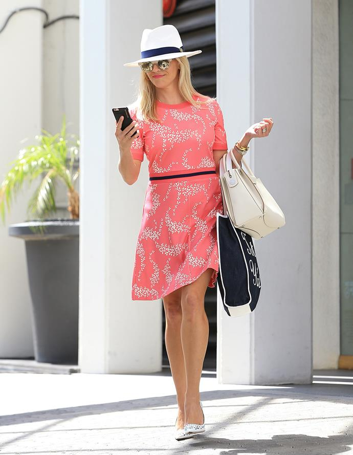 Reese Witherspoon is photographed walking around Los Angeles - check out the actress' tribute to *Legally Blonde* on its 15th anniversary in the next video. **Gallery continues after the video**