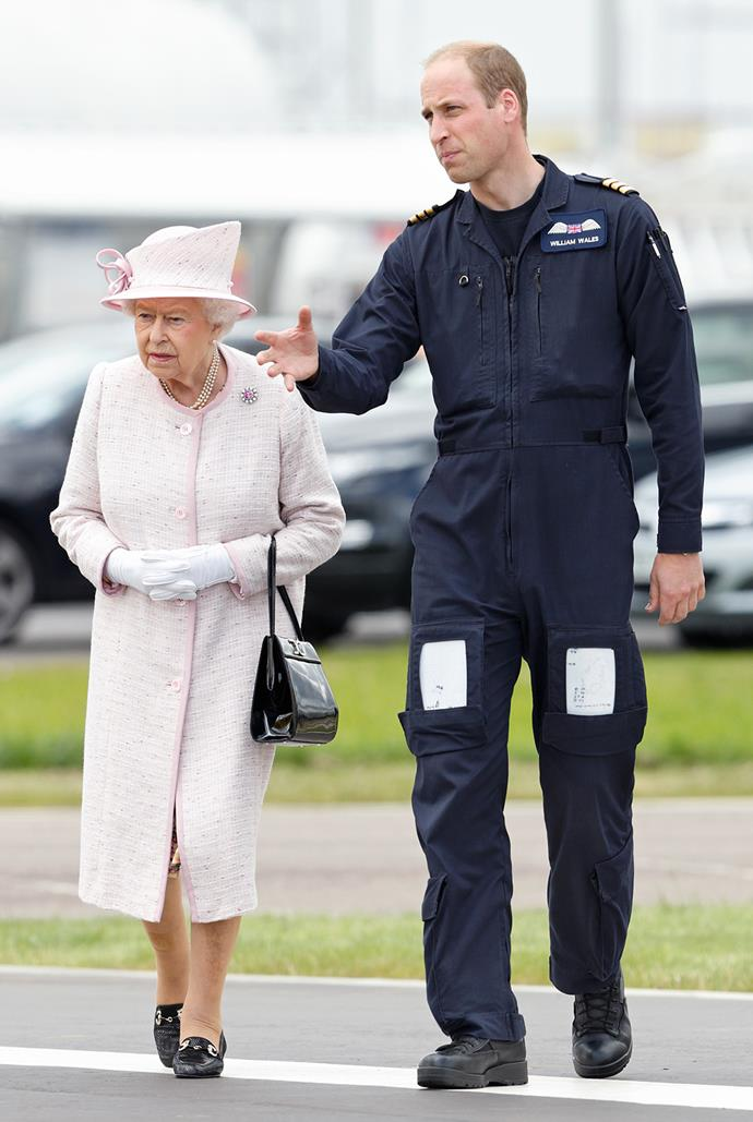 Prince William tours his grandmother, the Queen, around the new East Anglian Air Ambulance base at Cambridge Airport.
