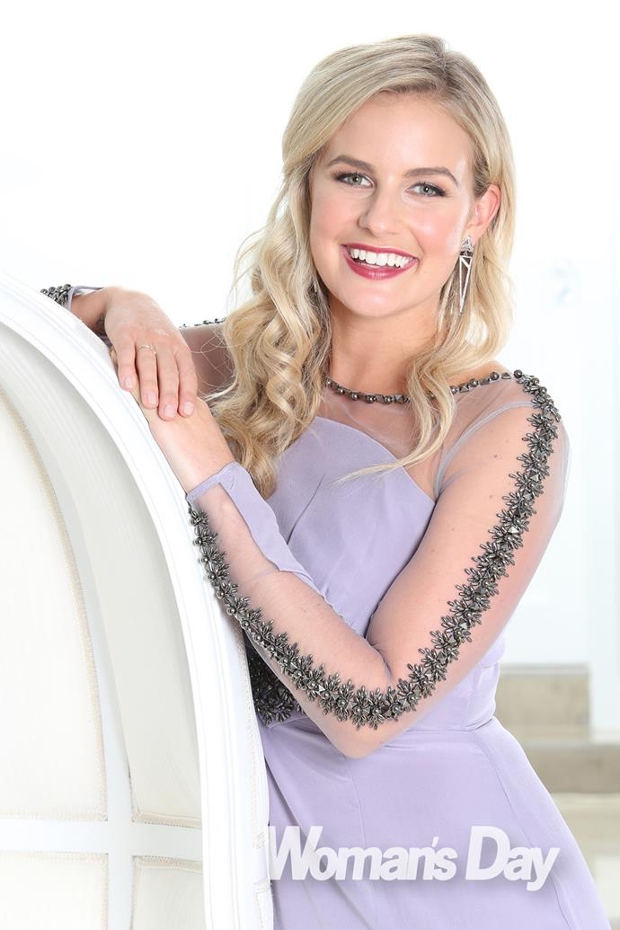 The blonde beauty rocks a lavender gown with sheer sleeves.