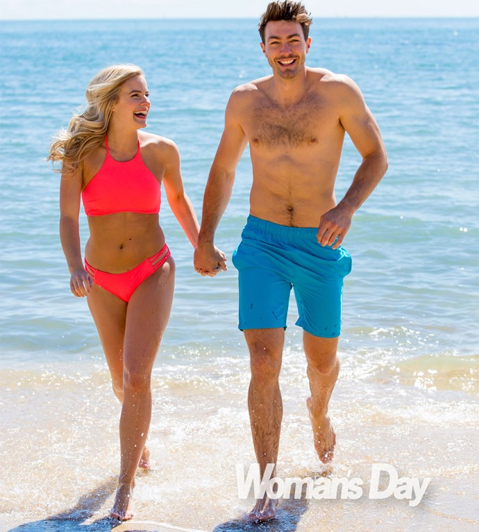 The media sales exec takes a stroll along the beach hand-in-hand with her equally hunky beau.