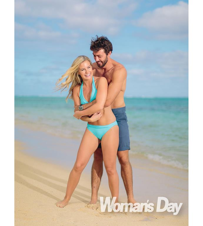 The pair are all loved-up during a beach-side photo shoot.