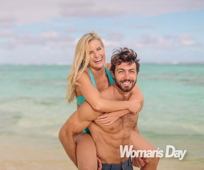 The couple share a laugh in the ocean as Art gives his gorgeous gal a ride.