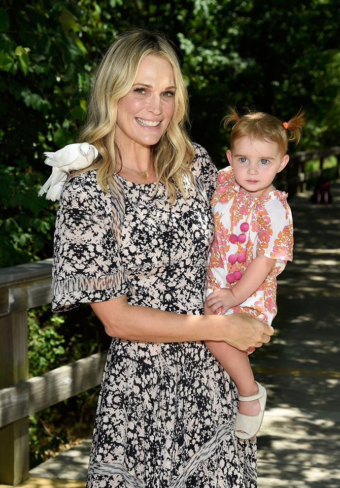 Actress Molly Sims cuddles her 16-month-old daughter Scarlett May close at a fundraiser event in New York.