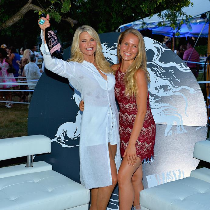 Like mother, like daughter! Christie Brinkley and Sailor Brinkley Cook raise a toast at a summer bash in New York.