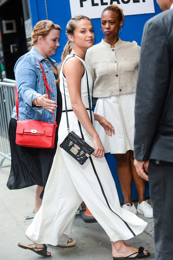 Alicia Vikander is snapped walking into the *Good Morning America* studios.
