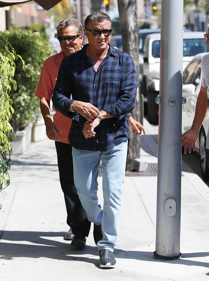 Sylvester Stallone keeps it cool in dark shades as he strolls around in Los Angeles.