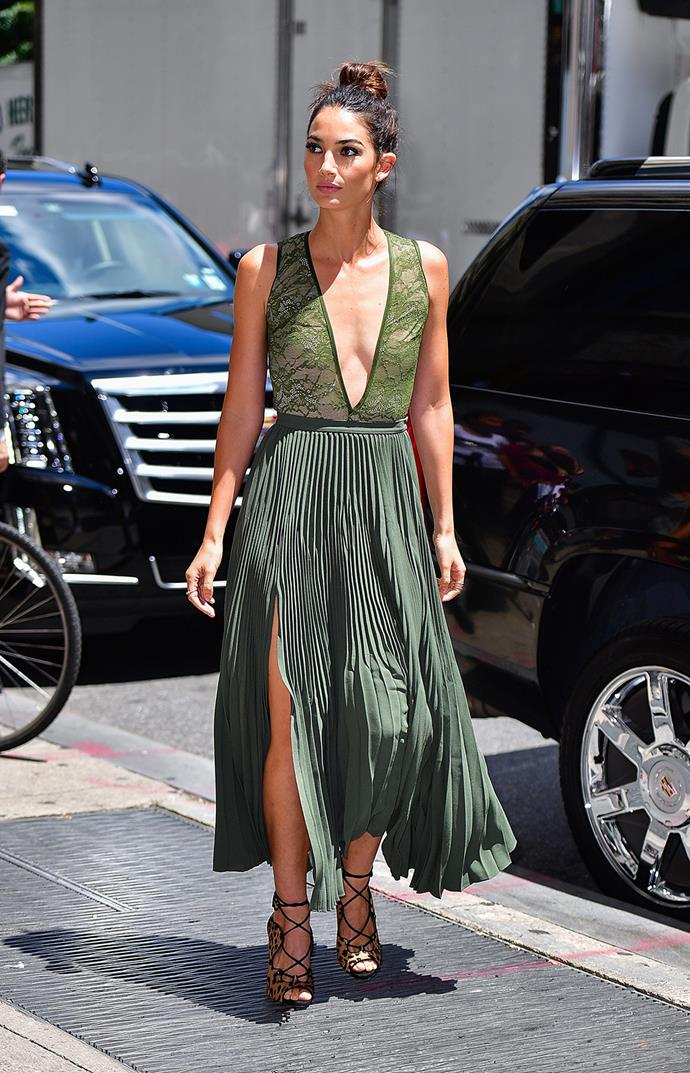 Victoria's Secret model Lily Aldridge takes the plunge in an all-green ensemble as she struts along the streets of New York.