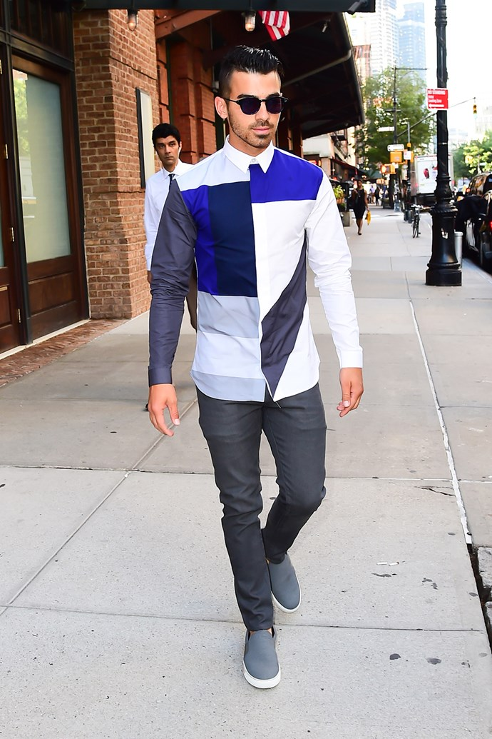 Joe Jonas teams dark shades with a long-sleeved shirt as he's spotted out in New York City.