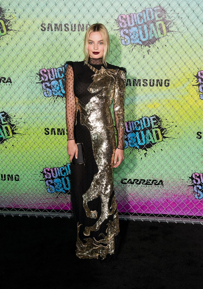 Margot Robbie dazzles in an unusual dress featuring a prancing unicorn as she attends the premiere of *Suicide Squad*.