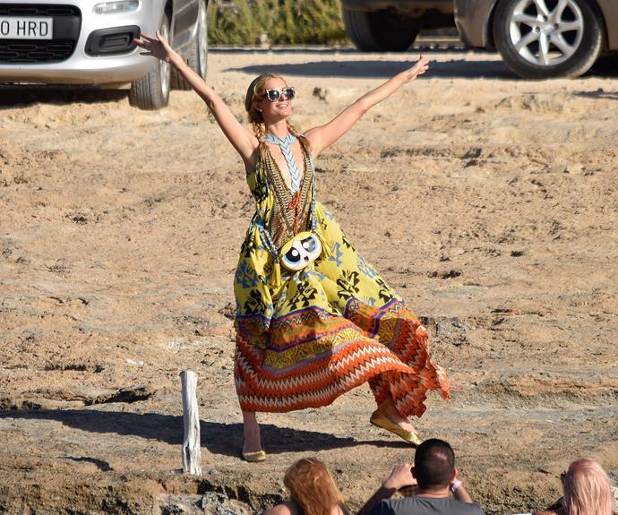 Feelin' free! Paris Hilton frolics on the sand in Ibiza.