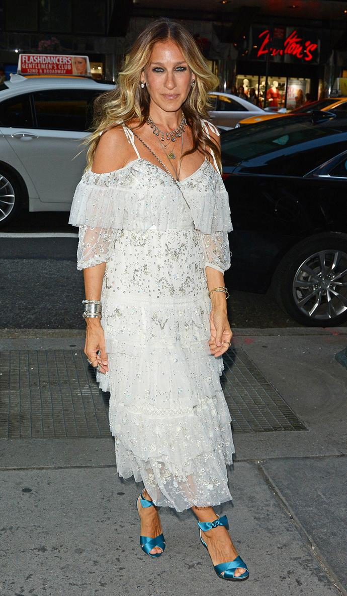 Sarah Jessica Parker pairs electric-blue heels with a tiered, ruffled white dress as she walks around New York.