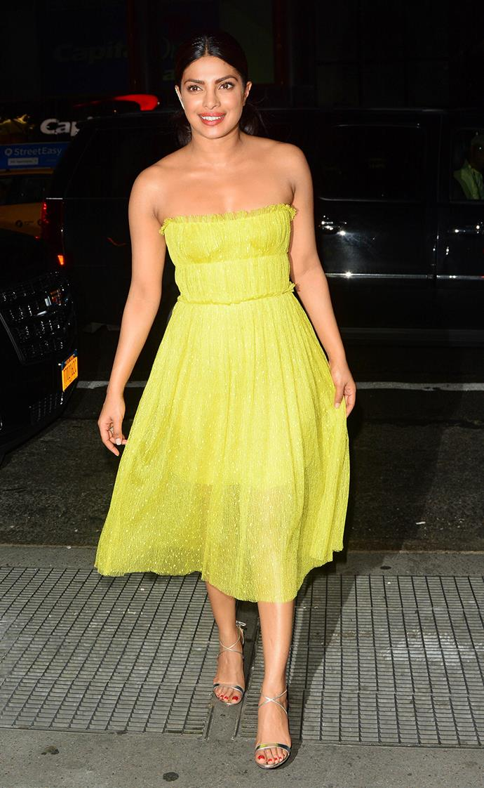 Priyanka Chopra dons a vibrant yellow dress for a night out on the town.