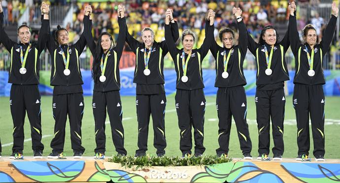 The girls join hands on the podium as they are awarded their silver medals. Photo: Getty