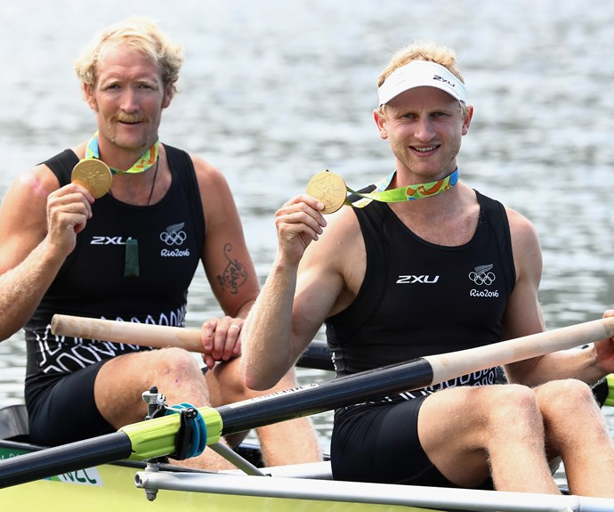 Victorious rowing pair Hamish Bond and Eric Murray pose with their gold medals after taking out the men's final.