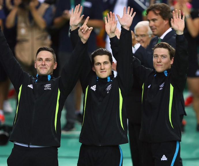 The trio wave to the crowds at the medal ceremony.