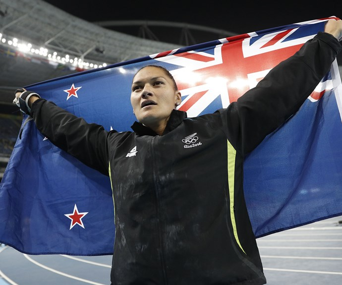 The Kiwi star proudly hoists the New Zealand flag above her head after the finals.