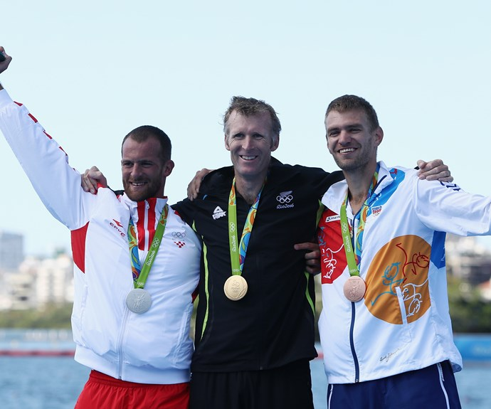 Mahe poses for a photo with Damir and the Czech Republic's Ondrej Synek, who won the bronze medal.