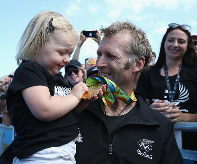 The Kiwi athlete celebrates with his adorable daughter Bronte after the race.