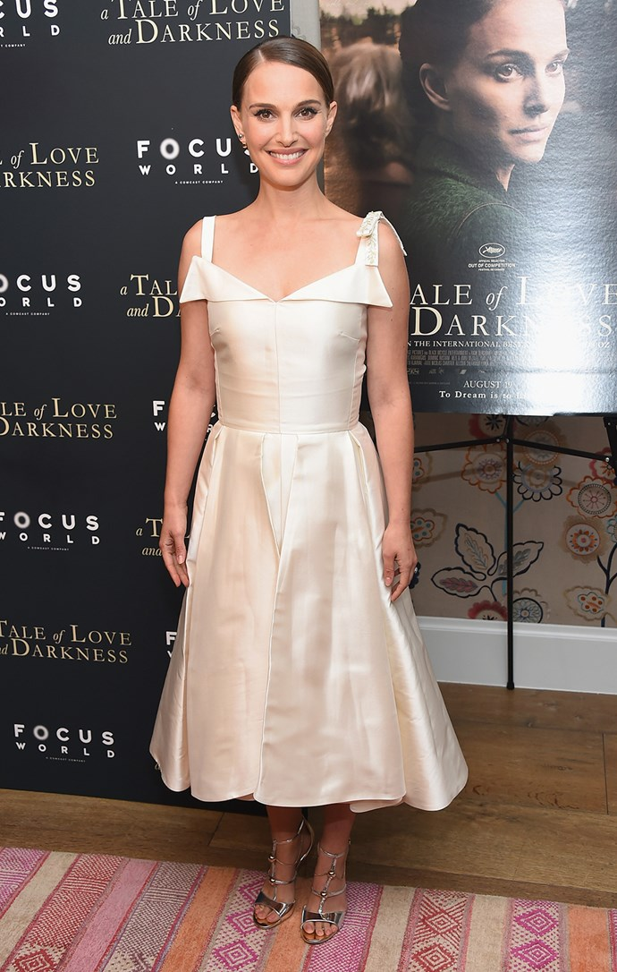 Natalie Portman wows in white at the premiere of *A Tale of Love and Darkness* in New York.
