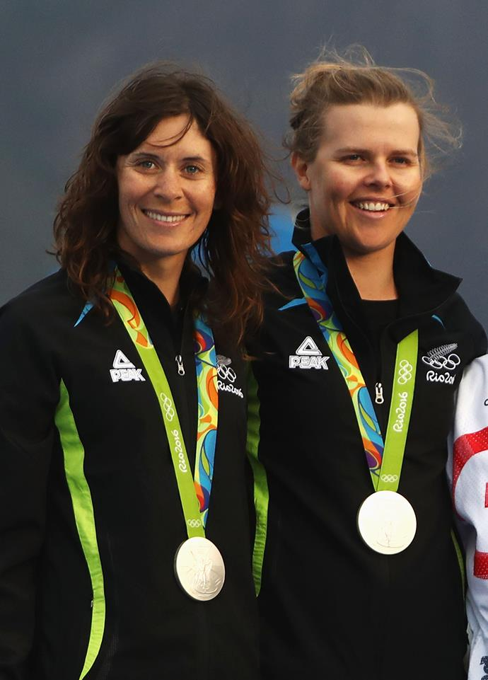 The duo pose proudly with their medals.