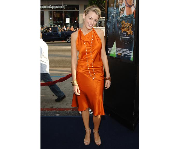 Not long after, at the *Sisterhood of the Travelling Pants* premiere, Blake's fame seemed to be changing her wardrobe for the better, in a bold choice of orange that worked well for her!