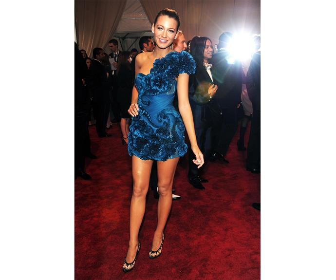 "And of course at the 2010 Met gala, who could compete with her in this bright blue Marchesa dress that showed off her endless legs. Blake definitely lived up to that year's theme ""American Woman: Fashioning a National Identity""."